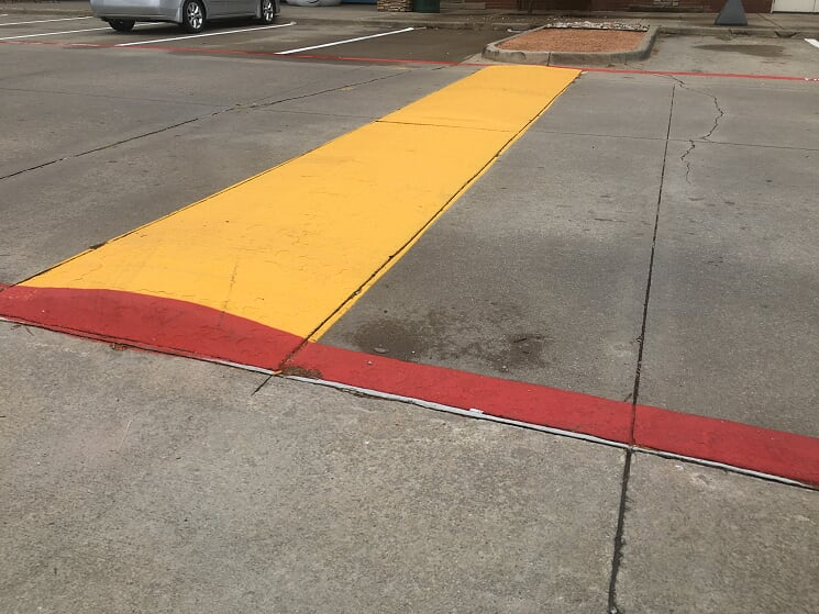 Yellow speed bump in parking lot Lenexa Kansas